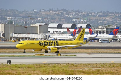 LOS ANGELES/CALIFORNIA - MAY 14, 2017: Spirit Airlines Airbus A321-231(WL) taxiing along the runway upon arrival at Los Angeles International Airport. Los Angeles, California USA