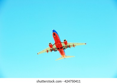 LOS ANGELES/CALIFORNIA - MAY 21, 2016: Southwest Airlines commercial aircraft approaching Los Angeles International Airport for a landing, Los Angeles, California USA