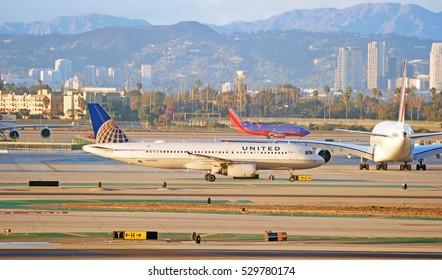 LOS ANGELES/CALIFORNIA - NOV. 27, 2016: United Airlines Airbus A320-232 aircraft taxiing along the runway at Los Angeles International Airport, Los Angeles, California USA