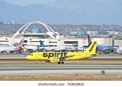 LOS ANGELES/CALIFORNIA - OCT. 21, 2017: Spirit Airlines Airbus A320-232 aircraft taxiing along the runway upon arrival at Los Angeles International Airport. Los Angeles, California USA