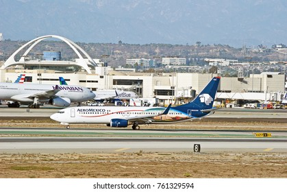 LOS ANGELES/CALIFORNIA - OCT. 21, 2107: Aeromexico Boeing 737-852 aircraft taxiing along the runway upon arrival at Los Angeles International Airport. Los Angeles, California USA