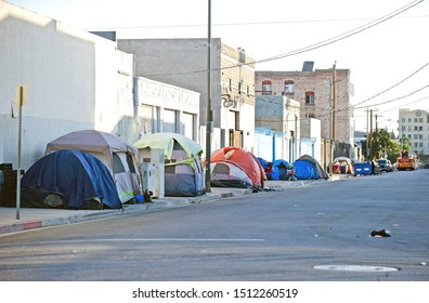 LOS ANGELES/CALIFORNIA - SEPT. 21, 2019: Homeless encampment along the roadside depicting the growing epidemic of homelessness in the city of Los Angeles. Los Angeles, California USA