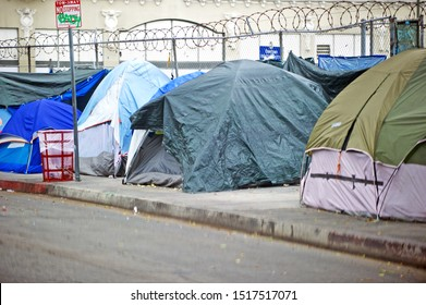 LOS ANGELES/CALIFORNIA - SEPT. 28, 2019: Homeless encampment along the roadside downtown depicting the growing epidemic of homelessness in the city of Los Angeles. Los Angeles, California USA