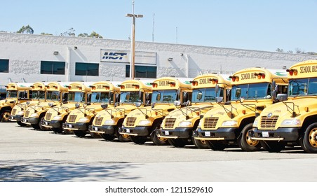 LOS ANGELES/CALIFORNIA - SEPT. 29, 2018: Mission School Transportation school buses parked in a parking lot in downtown Los Angeles. Los Angeles, California USA