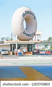 LOS ANGELES/CALIFORNIA - SEPT. 30, 2018: Randy's Donuts, an iconic Los Angeles establishment which attracts visitors from around the world. Los Angeles, California USA