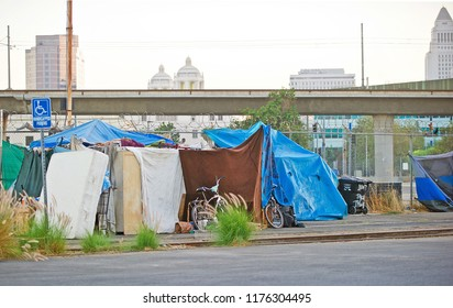 LOS ANGELES/CALIFORNIA - SEPT. 9, 2018: Homeless encampment along the roadside depicting the growing epidemic of homelessness in the City of Los Angeles. Los Angeles, California USA