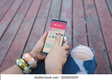 LOS ANGELES-CALIFORNIA-AMERICA-FEBRUARY-7-2018:Woman hand using Samsung note 8 smartphone with Reddit application in google play store