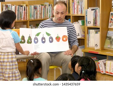 Los Angeles,California/USA - 05/05/2015  adult reading book to child
