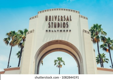 Los Angeles/California/USA - 07.19.2013: Entrance gate for the Universal Studios Hollywood, blue sky above and palm trees on the side of the gate.