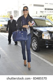 LOS ANGELES-MARCH 29: Model Kimora Lee Simmons at LAX airport. March 29 in Los Angeles, California 2011