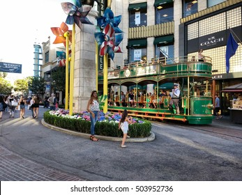 LOS ANGELES,OCT 1ST 2016: The Grove Trolley drives past the Barnes and Nobles Store. The Grove is a unique and upscale retail and entertainment complex in the Fairfax District of Los Angeles.