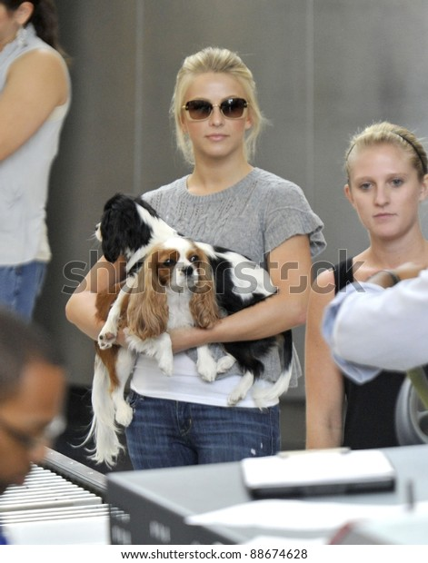 LOS ANGELES-SEPTEMBER 19: Television presenter Julianne Hough with her dogs at LAX airport. September19 in Los Angeles, California 2011