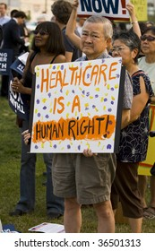 Los Angeles-September 3: Supporters of healthcare reform gather at a city park on September 3, 2009 in Los Angeles.  Rallies and town hall meetings are being held throughout the country.