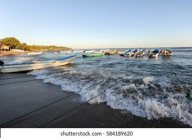Los Cobanos, El Salvador - 17 January 2014: boats on the beach of Los Cobanos on El Salvador