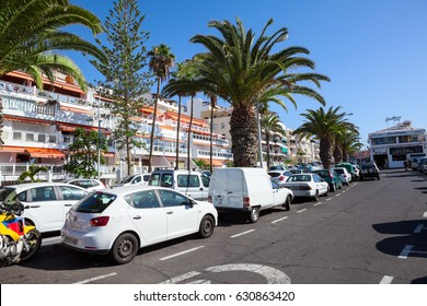 LOS CRISTIANOS, TENERIFE, SPAIN - CIRCA JAN, 2016: Parallel parking areas are in street of resort city. Full parking lots are in city at summer season
