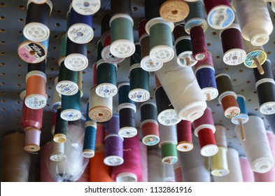 Los Gatos, California/USA - 01 31 2018: This was taken in a tailor shop where they do alterations and custom stitching. They offer thread bobbins for sale as well.