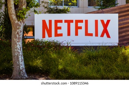 Los Gatos, CA/USA - May 12, 2018: Company sign marks entrance to NETFLIX Co.'s main office in Los Gatos, CA. NETFLIX provides streaming media, video-on-demand online, and DVD by mail.