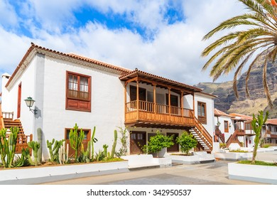 LOS GIGANTES, TENERIFE ISLAND - NOV 17, 2015: Traditional Canary style apartment buildings in Los Gigantes town, Tenerife, Canary Islands, Spain