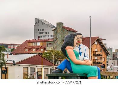 LOS LAGOS, CHILE, APRIL - 2017 - Famouse couple sculpture at Puerto Montt boardwalk