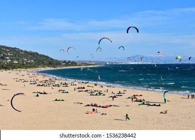 Los Lances Beach, Andalusia, Spain - September 29 2018: View on Los Lances Beach, Playa de los Lances, Kitesurfing, Kitesurfer, Windsurfing, Windsurfer, Tarifa
