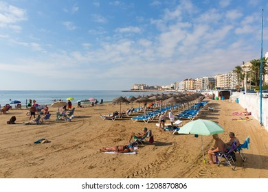 LOS LOCOS, TORREVIEJA, SPAIN-OCTOBER 6th 2018: Beautiful Spanish October sunshine and hot weather drew people to the sandy beach at Los Locos Torrevieja, Spain on Saturday 6th October 2018