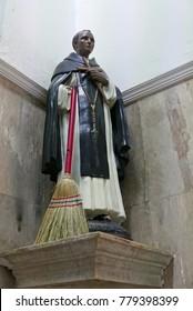 Los Mochis, Sinaloa, Mexico, September 6, 2017: Statue of Martin de Porres with a real broom in the Parroquia del Sagrado Corazón de Jesús church