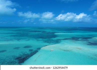 Los Roques, Caribbean Sea, Venezuela: Aerial view of a crystal water with fantastic landscape. Peace and a dream. Great caribbean sea view. Vacation in the blue sea and deserted islands.