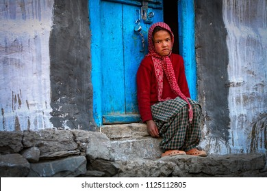 Losar village, Himachal Pradesh, India - July 12, 2012 : Portrait of unidentified tibetan girl at street of an spiti valley village.