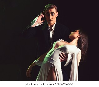 Lose control of your emotions. Couple in love with mime makeup. Mime man and woman act in romantic scene. Couple of mime artists perform romance on stage. Theatre actors miming through body motions.