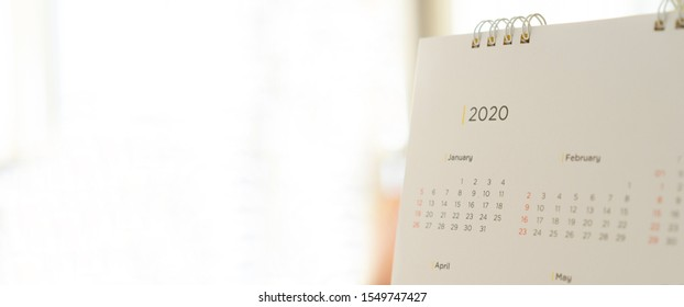 lose up side view on white calendar 2020 month schedule background to make appointment meeting or manage timetable each day for planning work and life concept