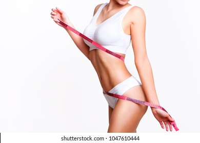 Lose weight, slim line of a beauty young woman body in underwear.