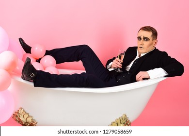 Lose yourself in your favourite drink. Mime man has celebration party with champagne. Mime actor enjoy bathing in bath. Comedian actor celebrate holidays. Happy bubble bath day. Bathing and relaxing.