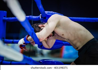 loser of fight boxer on ropes of corner ring after fight