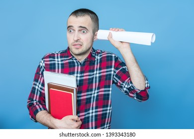 Loser or student with books, guy eavesdropping, portrait, blue background, copy space