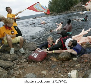 LOSEVO, LENINGRAD OBLAST - AUGUST 26 : Participants in action at rafting on inflatable dolls Bubble Baba Challenge 2006 at Losevo Rapids in Losevo, Leningrad Oblast on August 26, 2006.