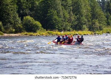Losevo, Russia - CIRCA September 2017: People are engaged in extreme sports. Rafting on the river. Passing dangerous sections of the river on the raft.