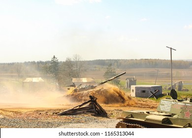 Loshany, Belarus - April 21 2018: Military exercise demonstration of tanks by the Belarusian Army. In this picture, a tank is crossing a mud pond, having been completely submerged