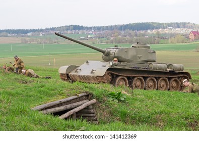 LOSHANY, BELARUS - MAY 5: Soviet T-44 tank supported by infantry moves to attack during historical reenacting show at Stalin's Line memorial on May 05, 2013 in Loshany, Belarus
