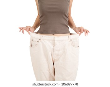 losing weight - anonymous woman showing how much weight she lost, white background