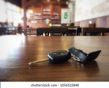 Loss car key on brown wood table in restaurant