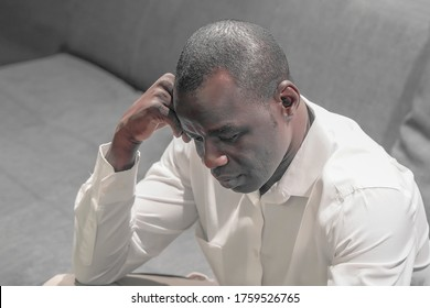 Loss of a loved one. Grief in the family. Sad face depressed elderly african man. Very sad elderly man. Concept of loneliness and pain.