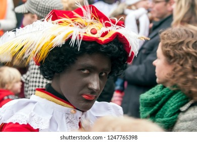 LOSSER, OVERIJSSEL / NETHERLANDS – NOVEMBER 17 2013: Naughty Black Piet looking at photographer.