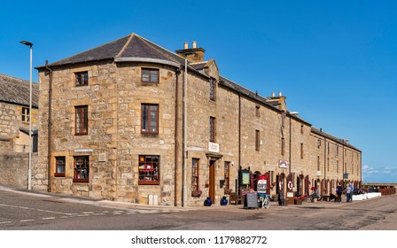 LOSSIMEOUTH, MORAY, SCOTLAND - 29 AUGUST 2018: This is an architectural view of some of the business premises in Pitgaveny Street, Lossiemouth, Moray, Scotland on 29 August 2018.
