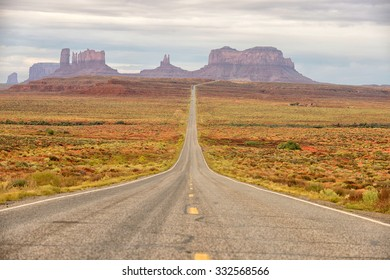 lost and alone on a famous empty road in the middle of nowhere in monument valley