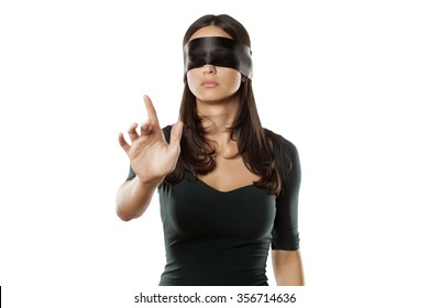lost blindfolded woman on a white background