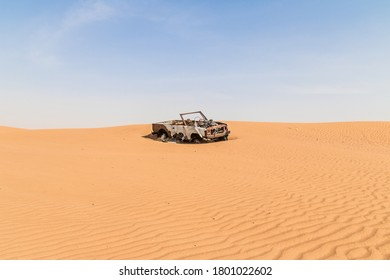 Lost and burned off road car in the desert.