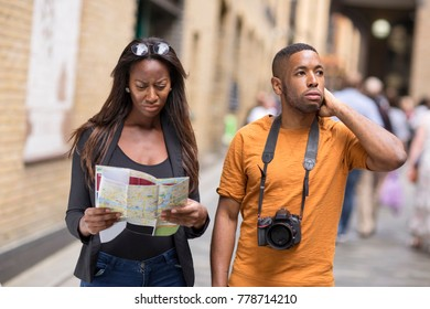 lost couple looking disorientated holding a map