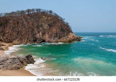 The lost and forgotten bay of Pichilinguillo with its beautiful turquoise waters between Lazaro Cardenas and Acapulco, Michoacan state, Mexico.