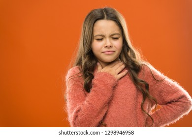 Lost her voice. Sore throat quick remedies. Kid feel pain in throat. Suffer from pain neck. Girl painful face orange background. Health care and medicine. Sore throat remedies. Throat pain treatment.