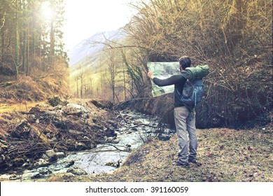 lost man observing map to find the the right way